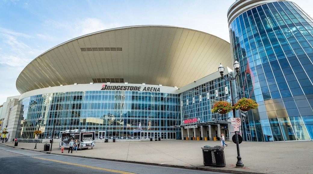 Bridgestone Arena featuring modern architecture, a city and signage