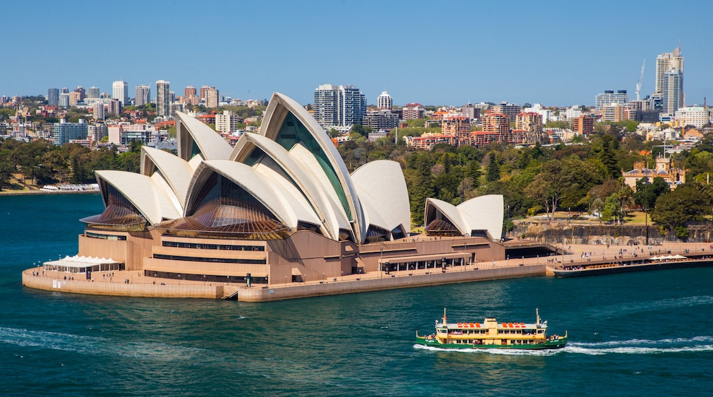 Sydney Opera House showing a monument, modern architecture and a city