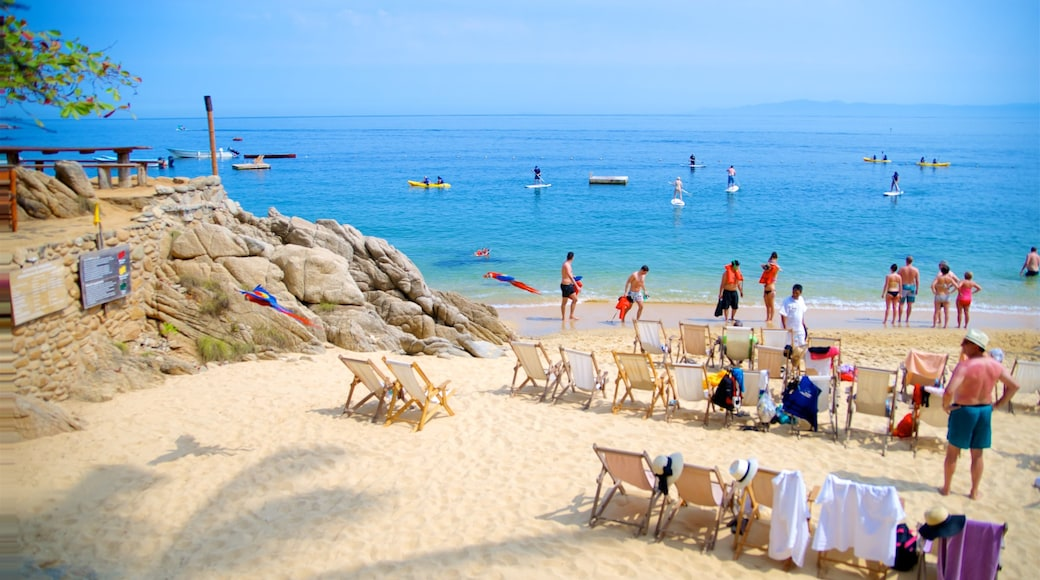 Puerto Vallarta showing a beach, general coastal views and kayaking or canoeing
