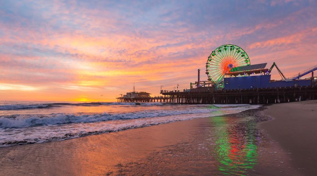 Santa Monica Pier featuring general coastal views, a sunset and a sandy beach