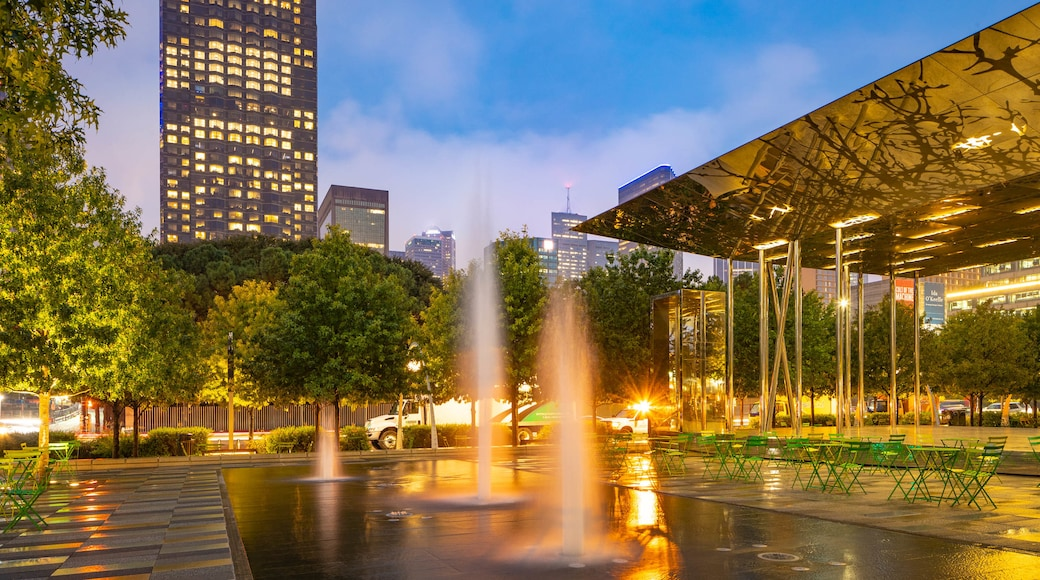 Klyde Warren Park featuring night scenes and a fountain