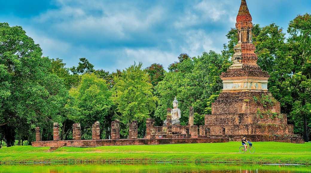 Sukhothai Historical Park which includes heritage elements and a statue or sculpture