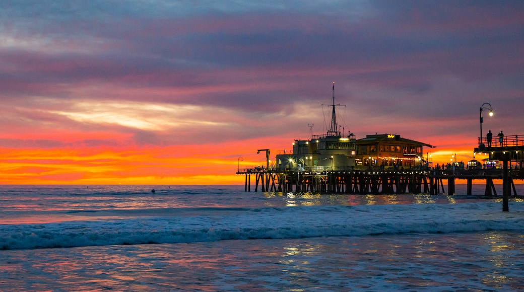 Santa Monica Pier which includes a sunset and general coastal views