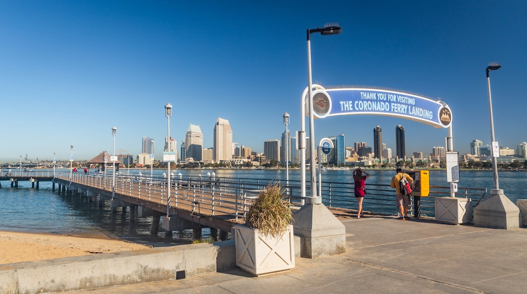 Coronado Ferry Landing showing signage and a bay or harbor