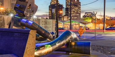 Deep Ellum featuring a city, night scenes and outdoor art