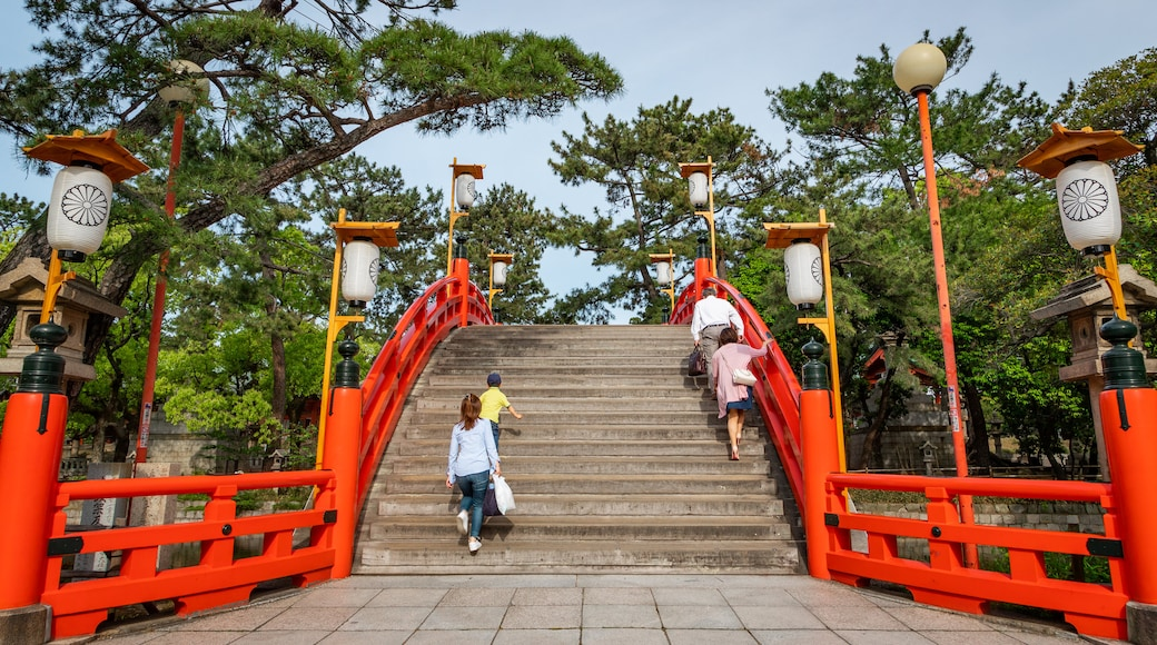 Sumiyoshi Taisha Shrine showing a bridge as well as a small group of people