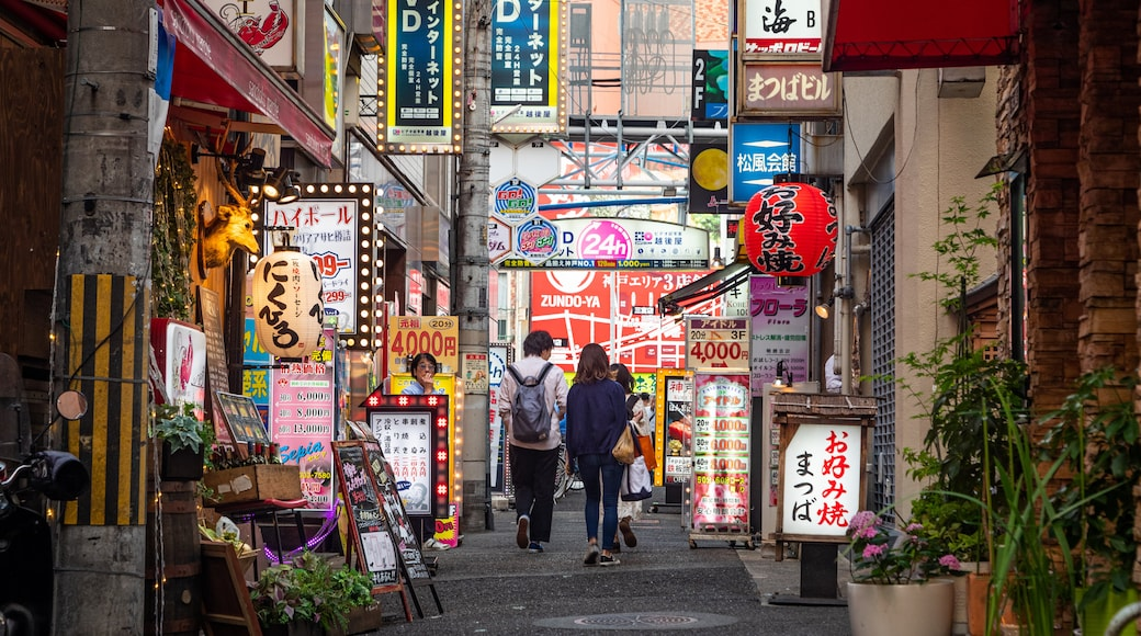 Kobe showing street scenes and signage as well as a couple