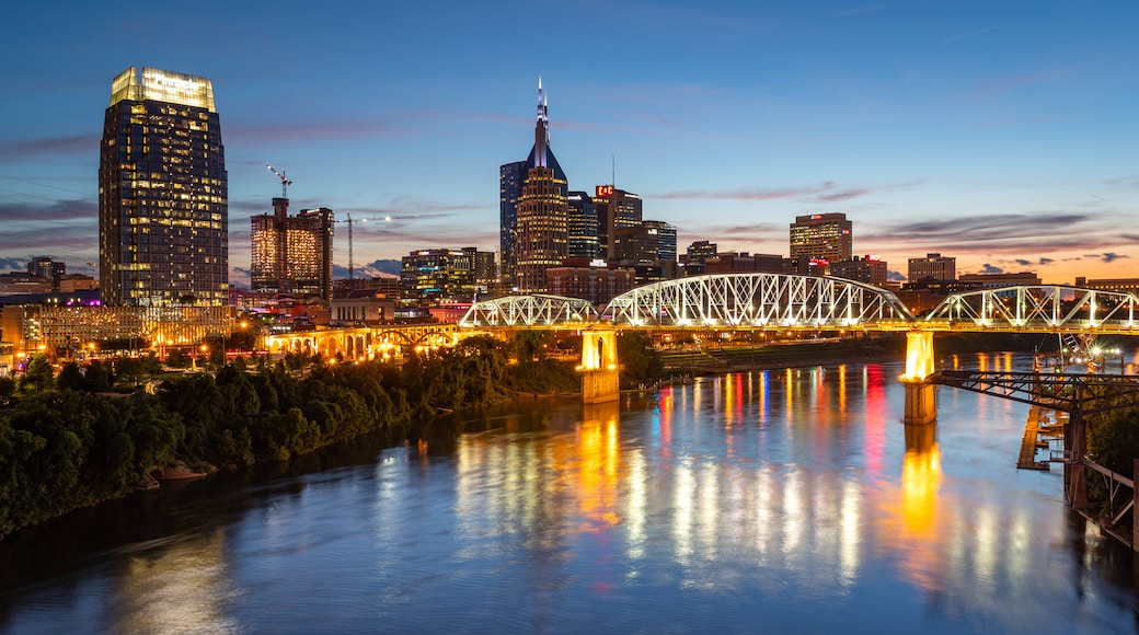 Downtown Nashville featuring a city, a sunset and a river or creek