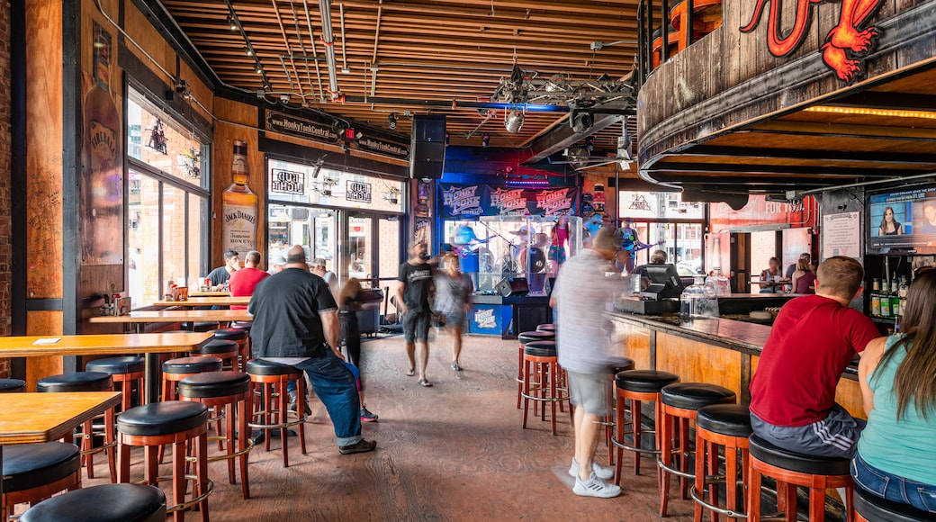 Downtown Nashville which includes a bar and interior views