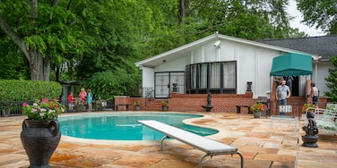 Graceland showing a house and a pool