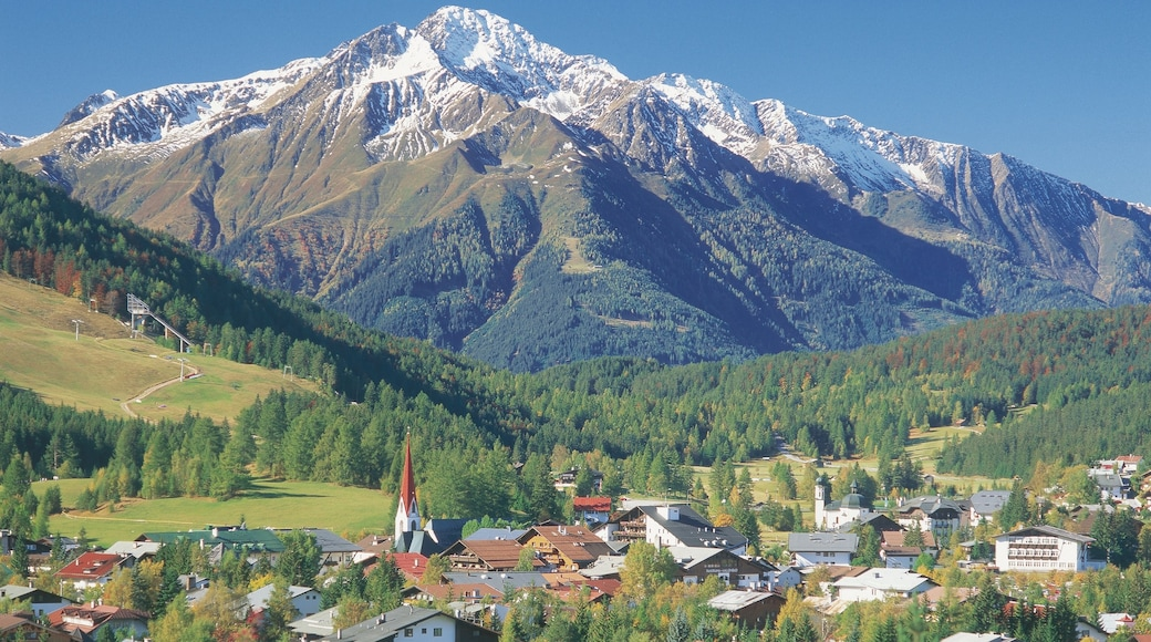 Seefeld in Tirol showing mountains, forest scenes and a small town or village