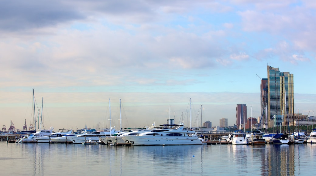 Baywalk which includes a marina, a bay or harbour and boating
