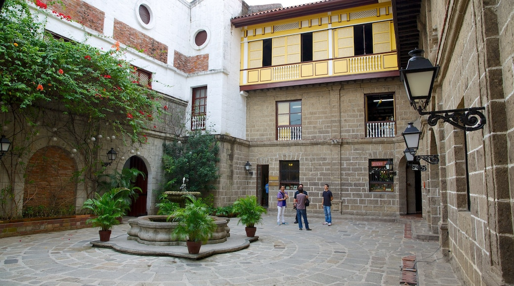 Casa Manila Museum featuring a square or plaza as well as a small group of people