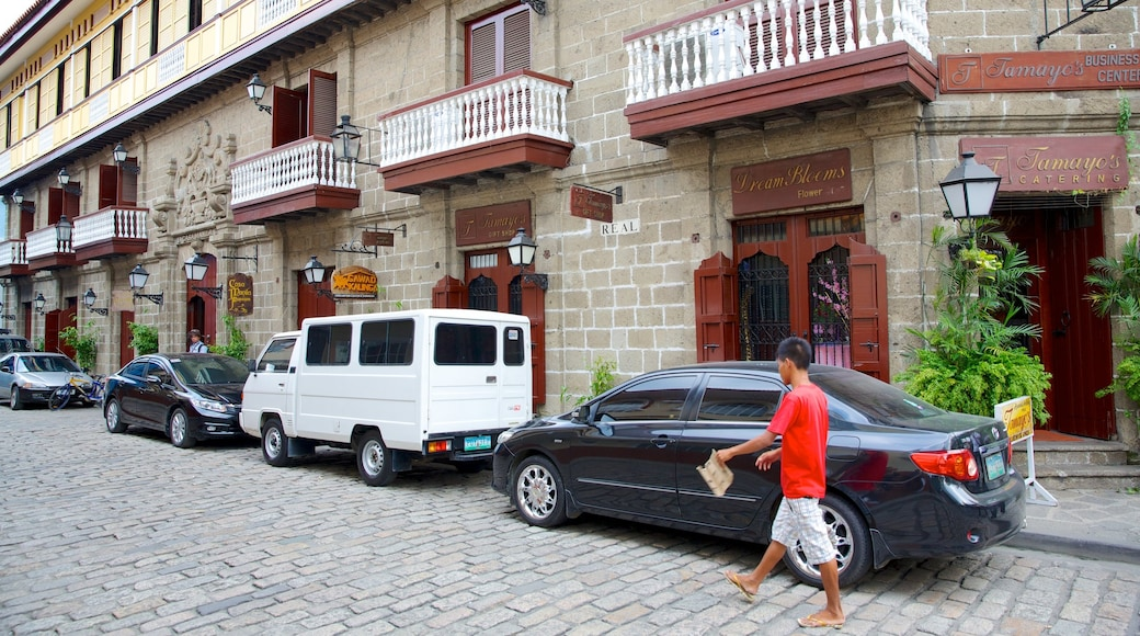 Casa Manila Museum showing street scenes and a city as well as an individual male