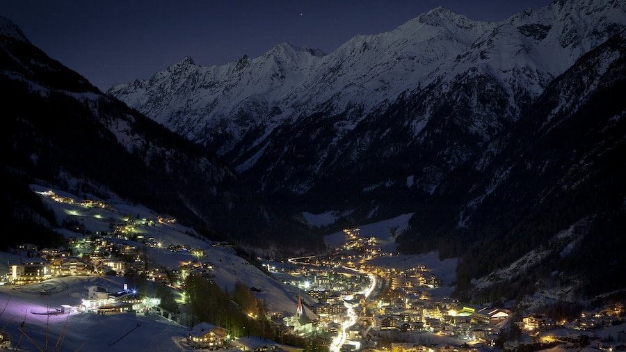 Austria which includes snow, mountains and a small town or village
