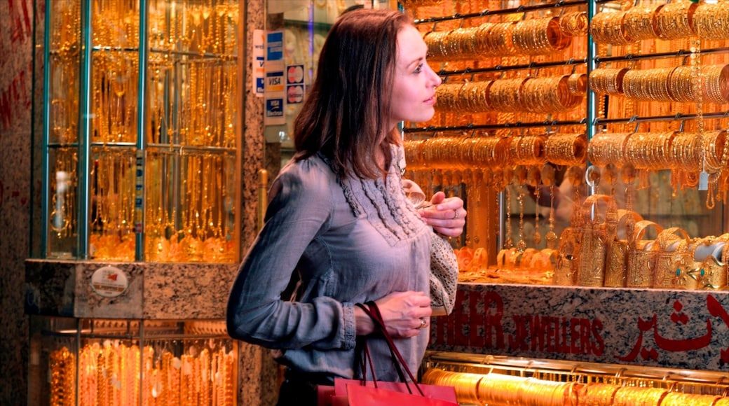 Gold Souk which includes interior views, shopping and markets