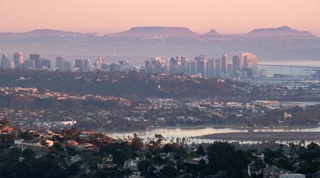 Mount Soledad showing a sunset, a city and landscape views