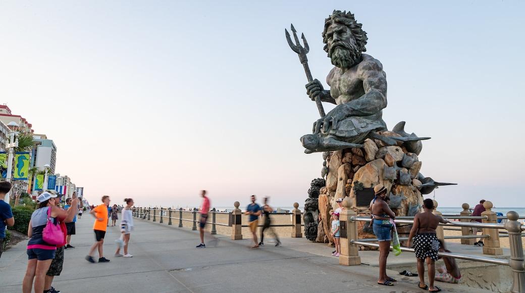 Neptune Statue which includes a sunset, street scenes and a statue or sculpture