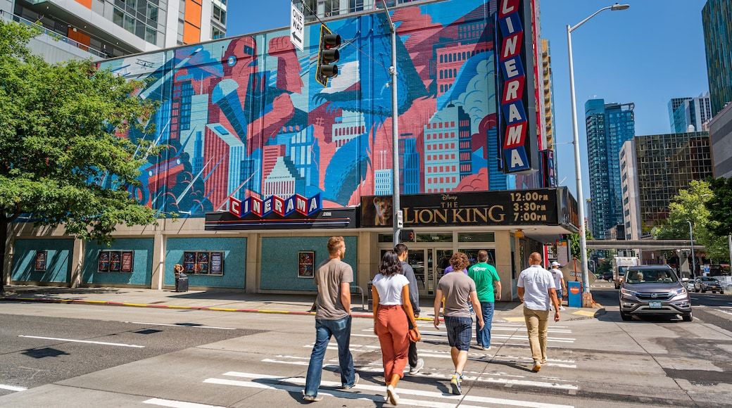 Cinerama featuring outdoor art, a city and street scenes