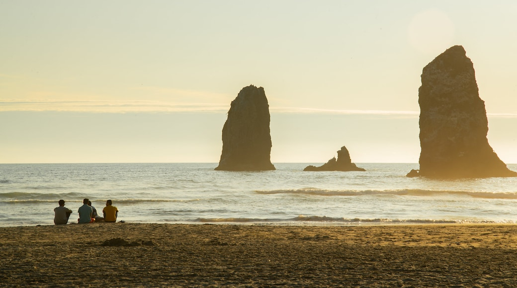 Cannon Beach which includes a beach, general coastal views and a sunset