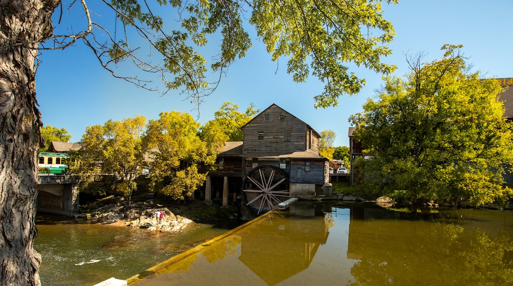 Old Mill which includes heritage elements and a river or creek