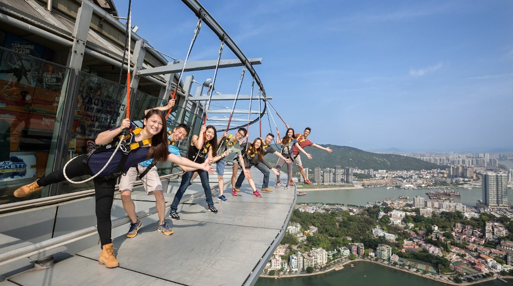 Macau Tower showing bungee jumping as well as a small group of people