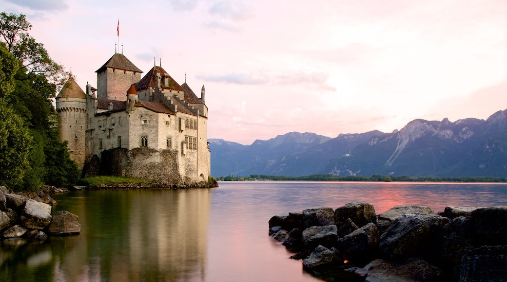 Chateau de Chillon featuring a castle, heritage architecture and a lake or waterhole