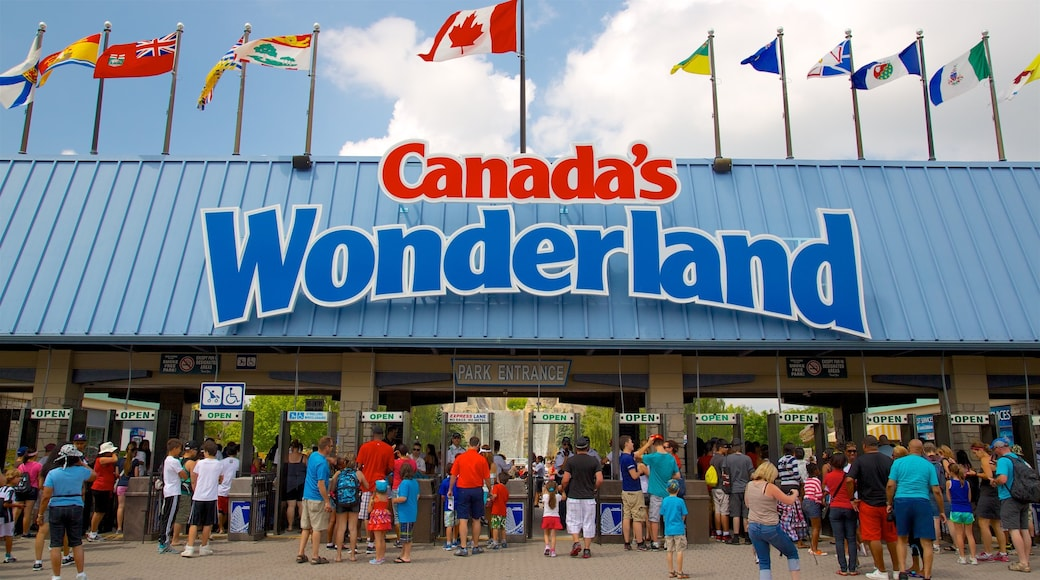 Canada\'s Wonderland showing a city, signage and rides