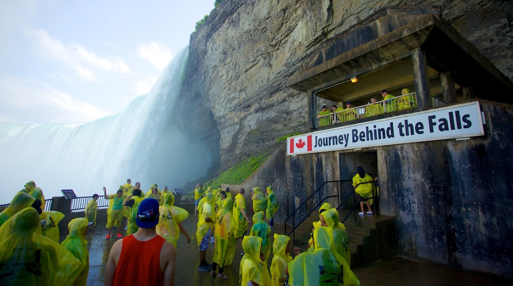 Journey Behind The Falls which includes a waterfall, hiking or walking and signage