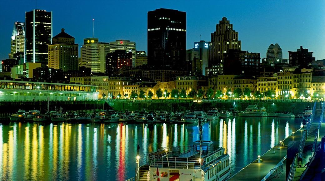 Old Port of Montreal das einen Stadt, Bucht oder Hafen und bei Nacht