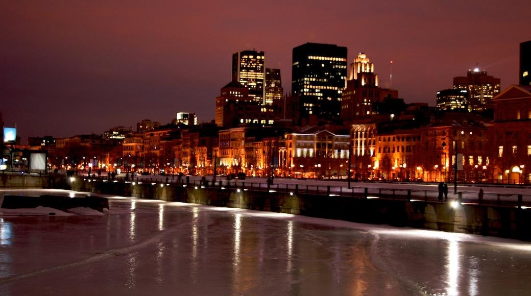 Old Port of Montreal welches beinhaltet bei Nacht, Stadt und Fluss oder Bach