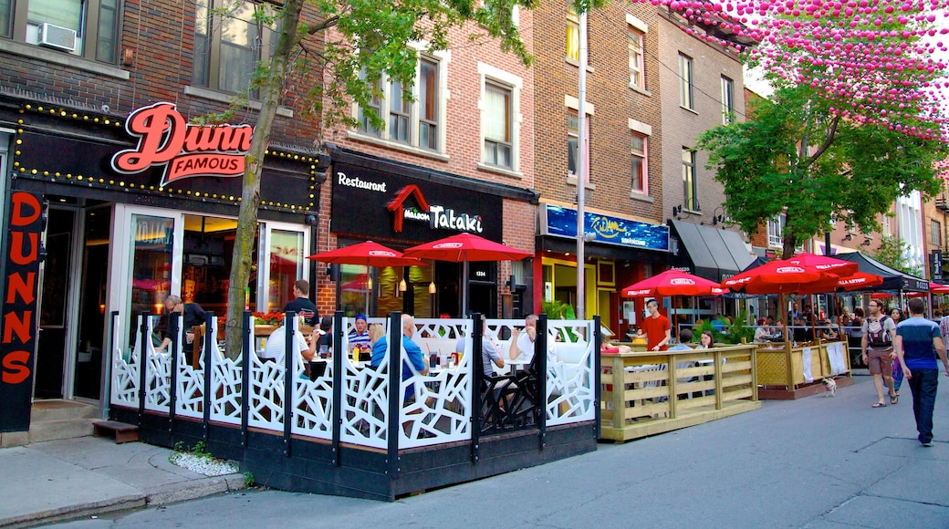 Gay Village which includes signage, outdoor eating and a city
