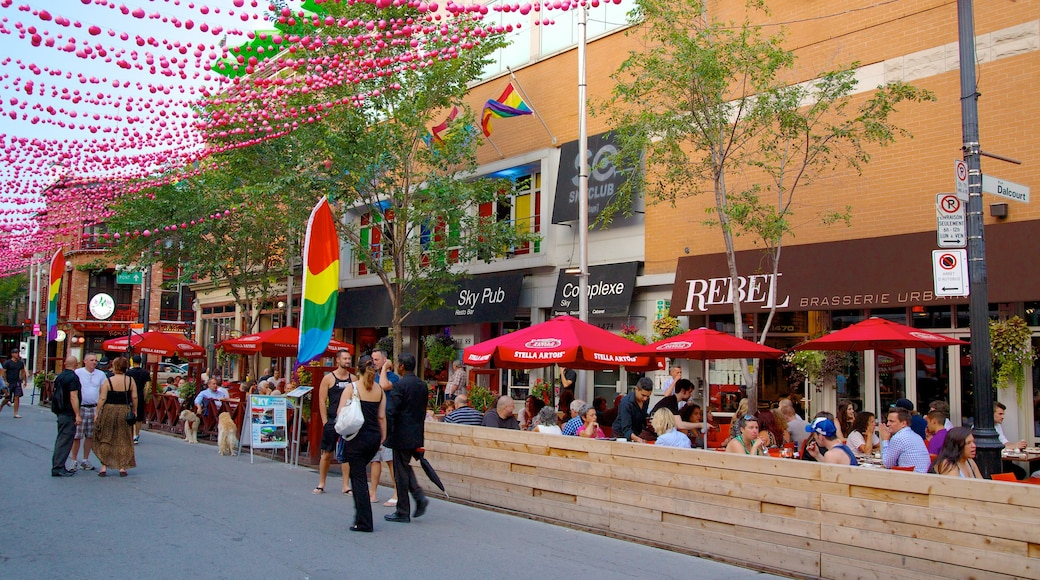 Gay Village which includes street scenes, signage and a bar