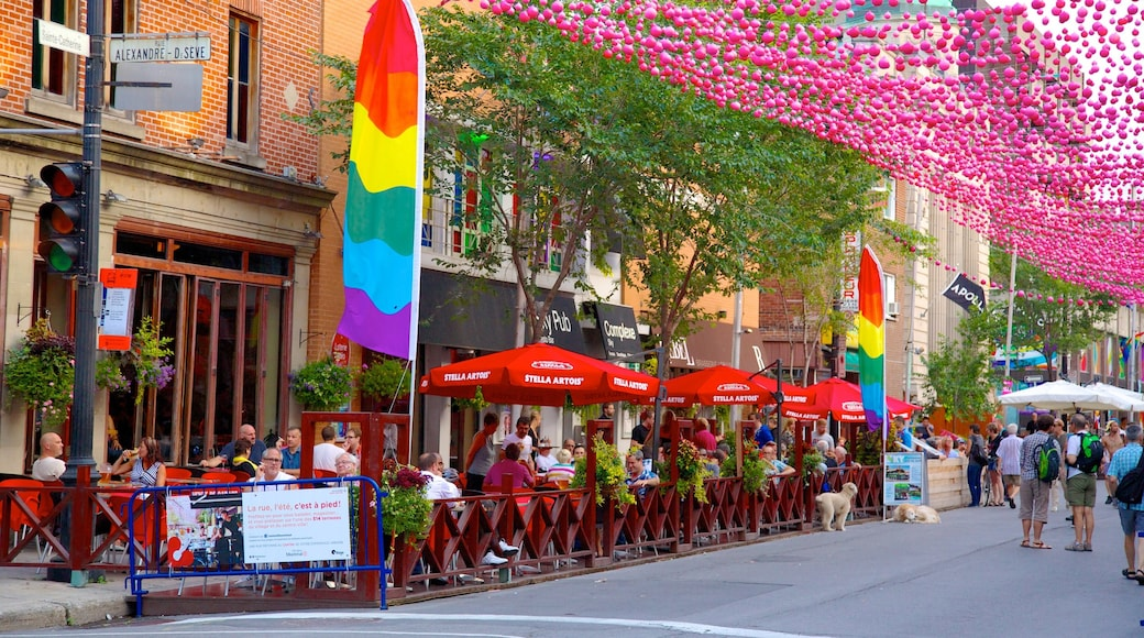Gay Village featuring outdoor eating, street scenes and café scenes