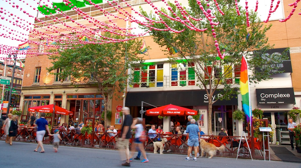 Gay Village featuring outdoor eating, street scenes and signage