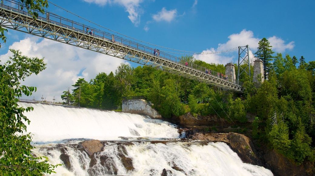 Montmorency Falls showing a suspension bridge or treetop walkway, a waterfall and a bridge
