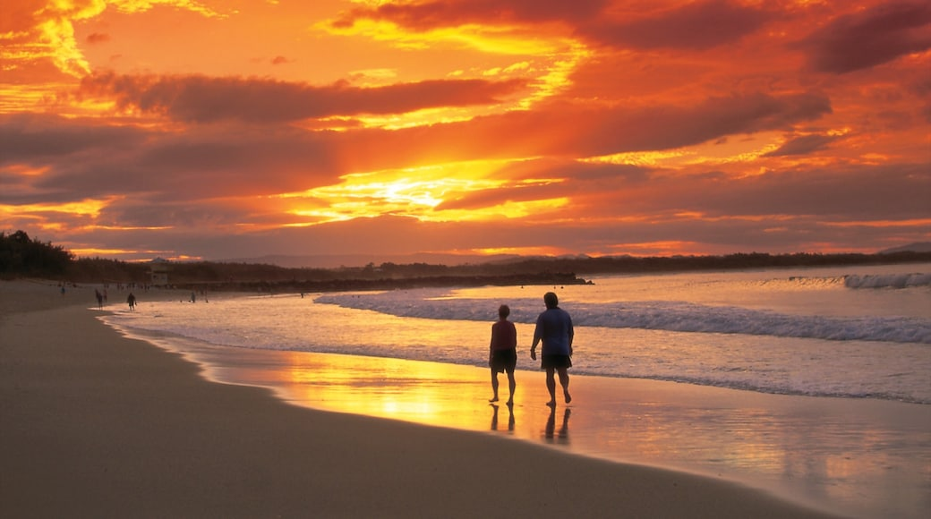 Noosa Heads showing a sandy beach and a sunset as well as a couple