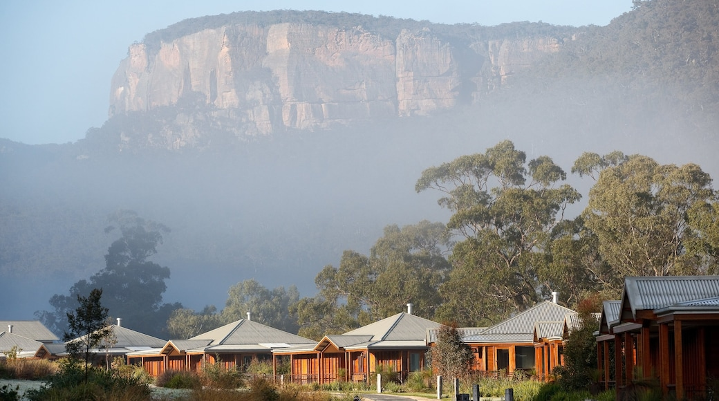 Blue Mountains which includes mist or fog, mountains and a small town or village