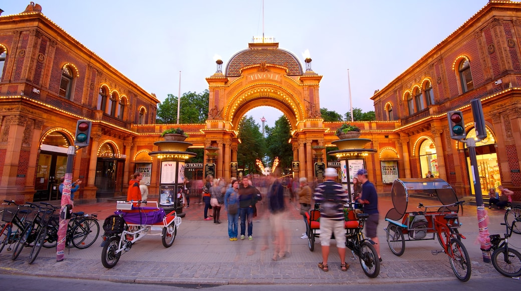 Tivoli Gardens featuring heritage architecture, rides and a city