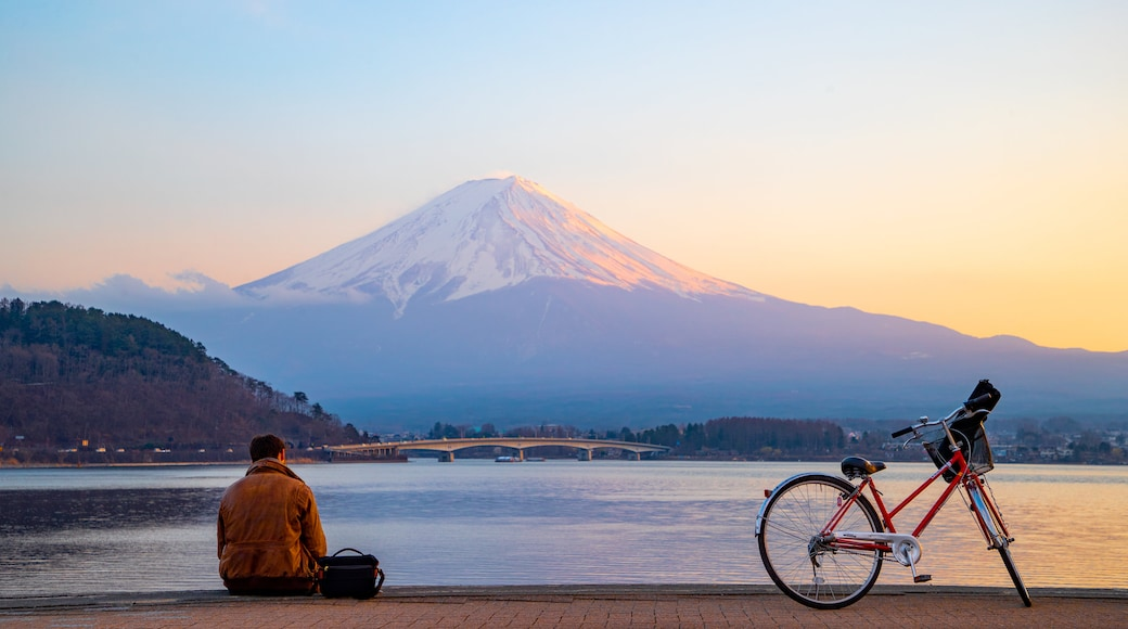 Chubu featuring a lake or waterhole, mountains and a sunset