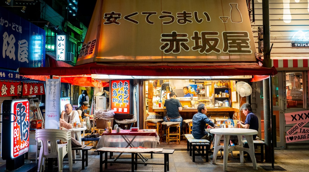 Shinsekai featuring night scenes, street scenes and outdoor eating