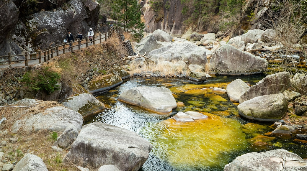 Shosenkyo which includes a pond and tranquil scenes as well as a small group of people