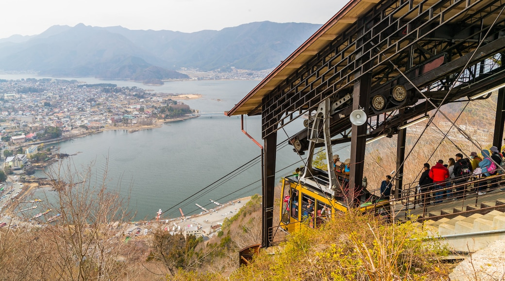 Mt. Kachi Kachi Ropeway which includes a gondola and a coastal town as well as a small group of people