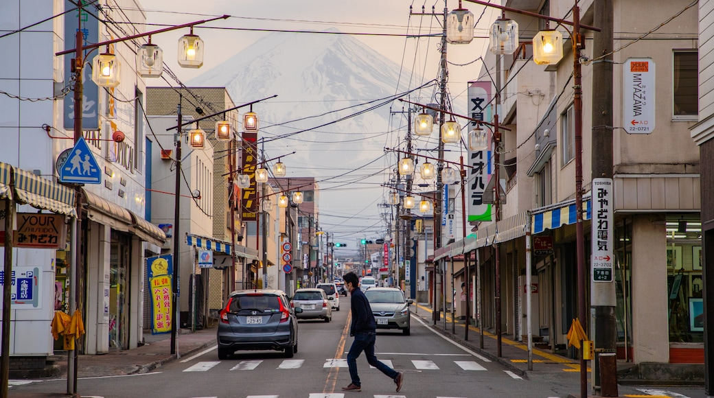 Fujiyoshida featuring street scenes as well as an individual male