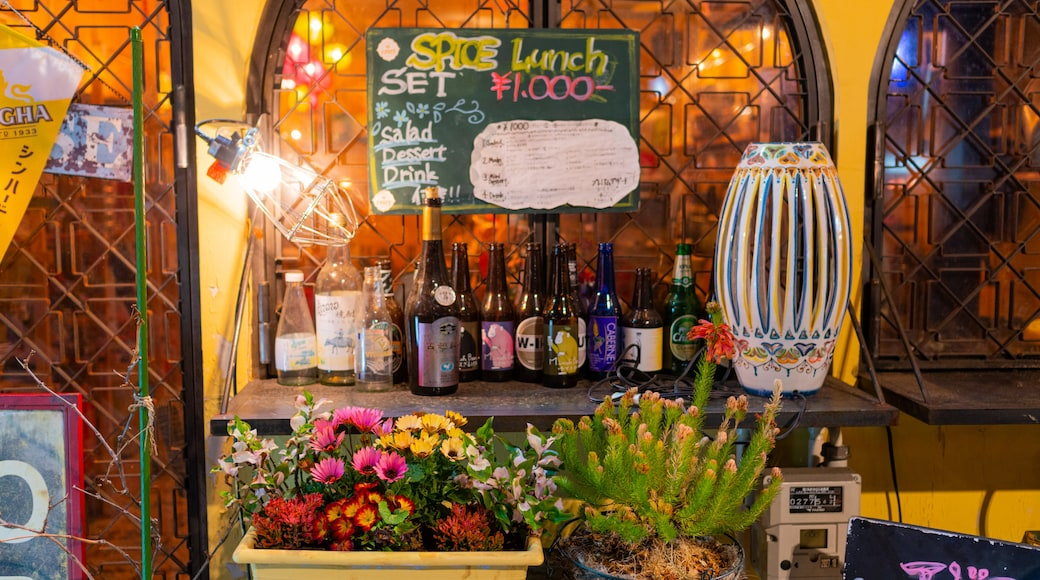 Kofu showing flowers, signage and drinks or beverages