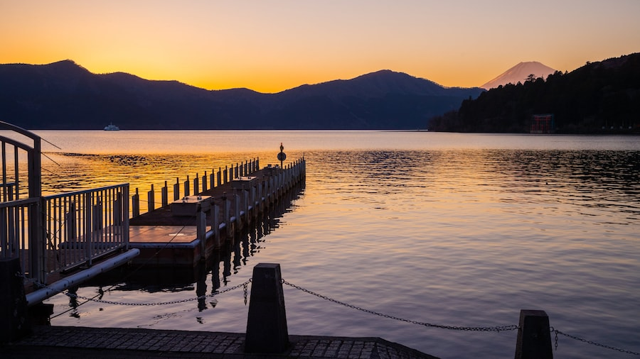 Hakone featuring a lake or waterhole and a sunset
