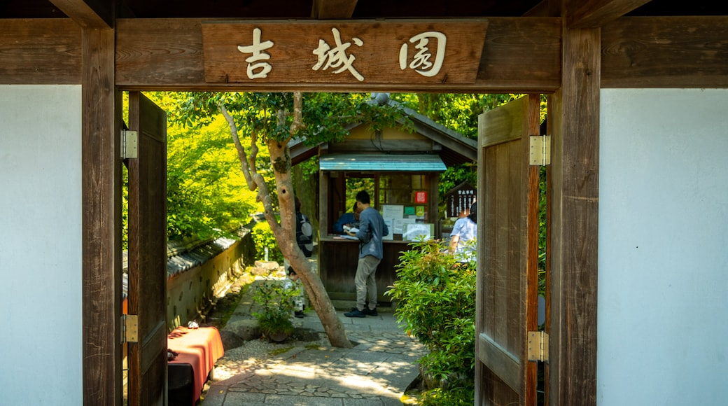 Yoshikien Garden which includes a garden and signage as well as an individual male