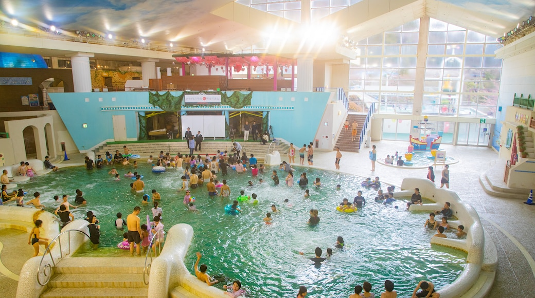 Hakone Kowakien Yunessun showing swimming, interior views and a pool