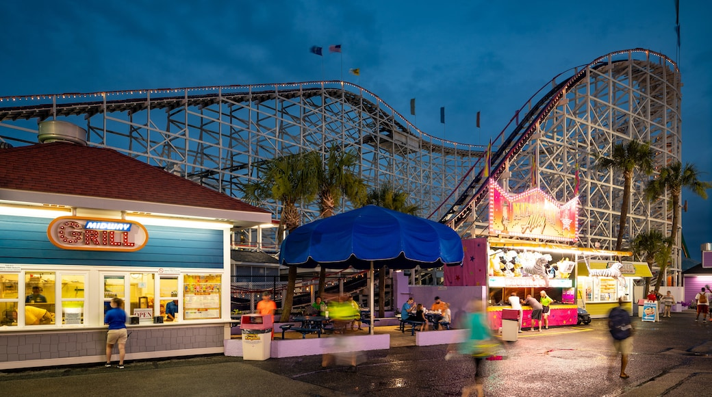 Family Kingdom Amusement Park showing night scenes and rides
