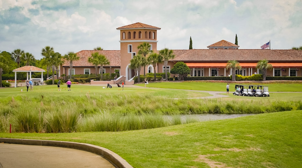Grand Dunes Golf Course featuring golf as well as a small group of people